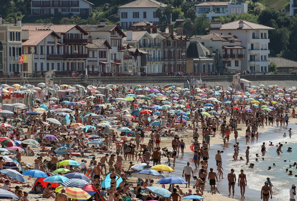 People sunbathe in Saint Jean de Luz' beach, southwestern France, Saturday, July 18, 2020. New French Prime Minister Jean Castex has announced that re...