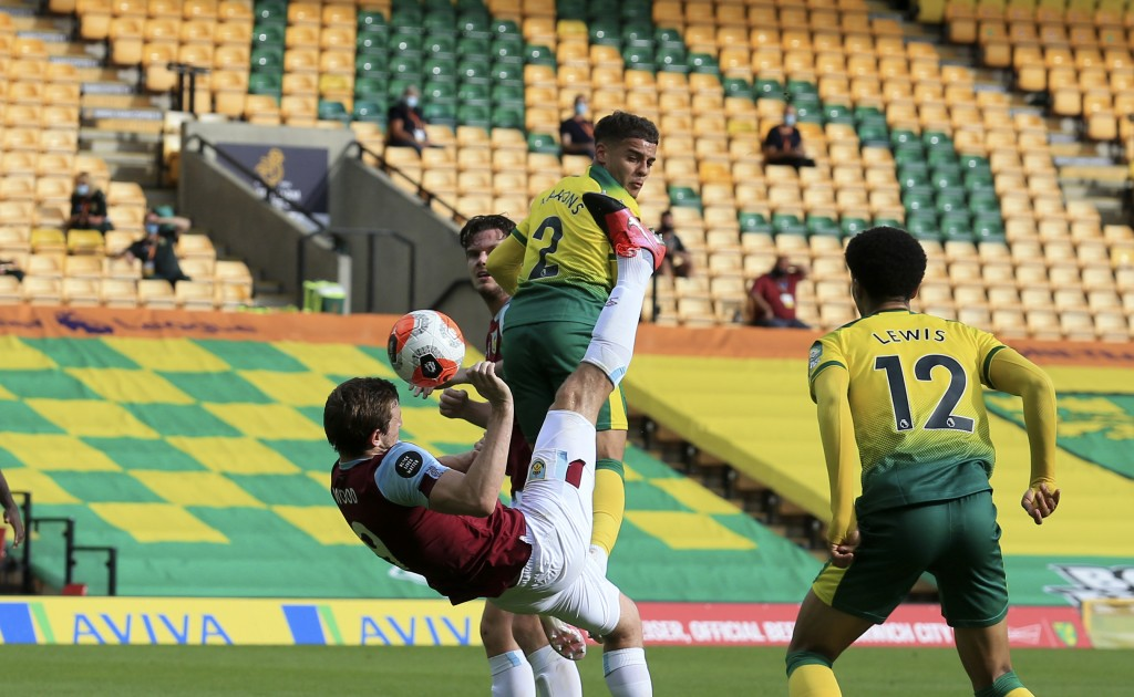 Burnley's Chris Wood scores his side's opening goal during the English Premier League soccer match between Norwich City and Burnley at Carrow Road Sta...