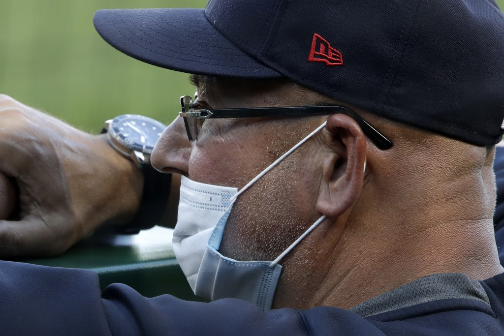 Cleveland Indians manager Terry Francona stands in the dugout during an exhibition baseball game against the Pittsburgh Pirates in Pittsburgh, Saturda...