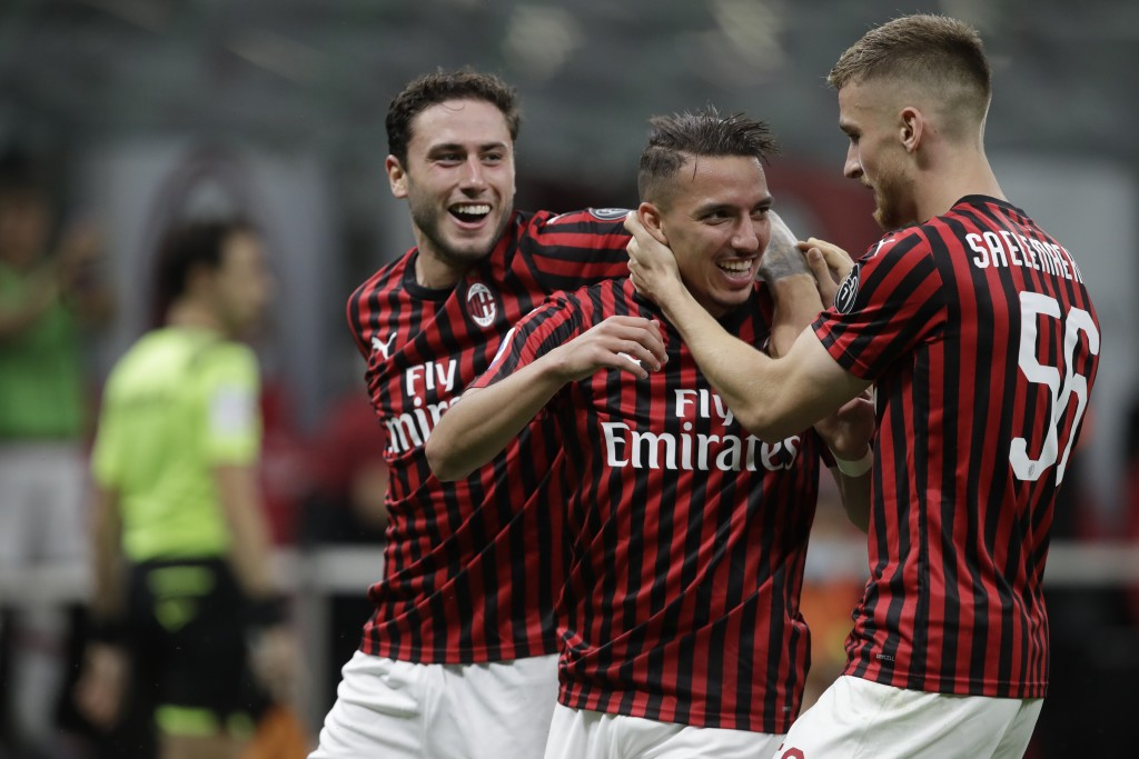 AC Milan's Ismael Bennacer, centre, celebrates with team players after scoring during a Serie A soccer match between AC Milan and Bologna, at the San ...