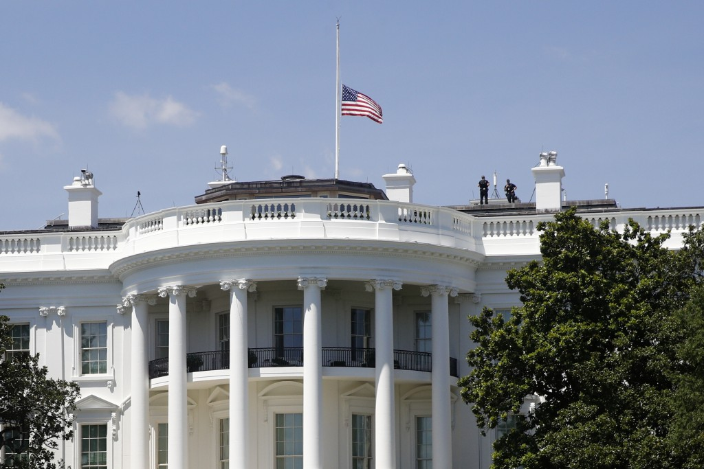 An American flag flies at half-staff over the White House in Washington, Saturday, July 18, 2020, in remembrance of Rep. John Lewis, D-Ga. Lewis, who ...