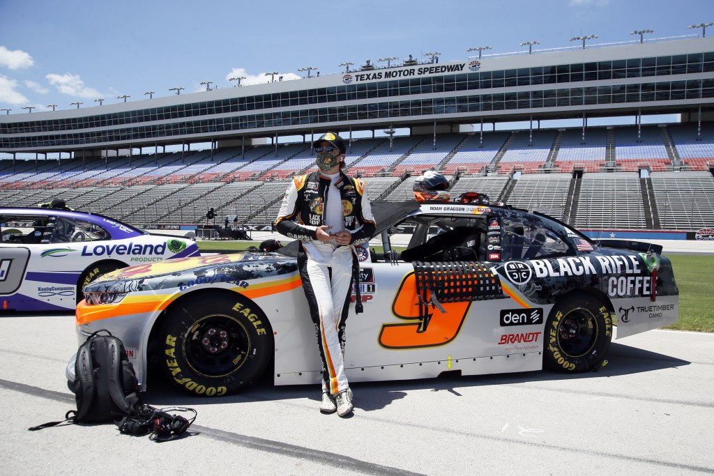 Noah Gragson stands next to his car prior to the NASCAR Xfinity auto race at Texas Motor Speedway in Fort Worth, Texas, Saturday, July 18, 2020. (AP P...