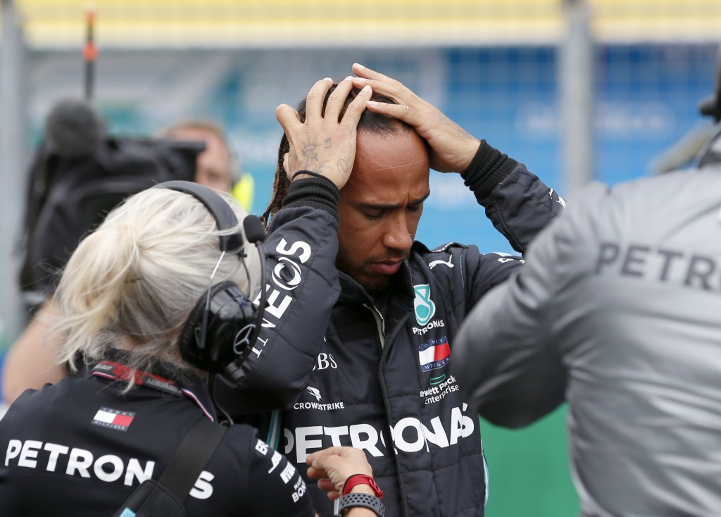 Mercedes driver Lewis Hamilton of Britain prepares for the Hungarian Formula One Grand Prix at the Hungaroring racetrack in Mogyorod, Hungary, Sunday,...