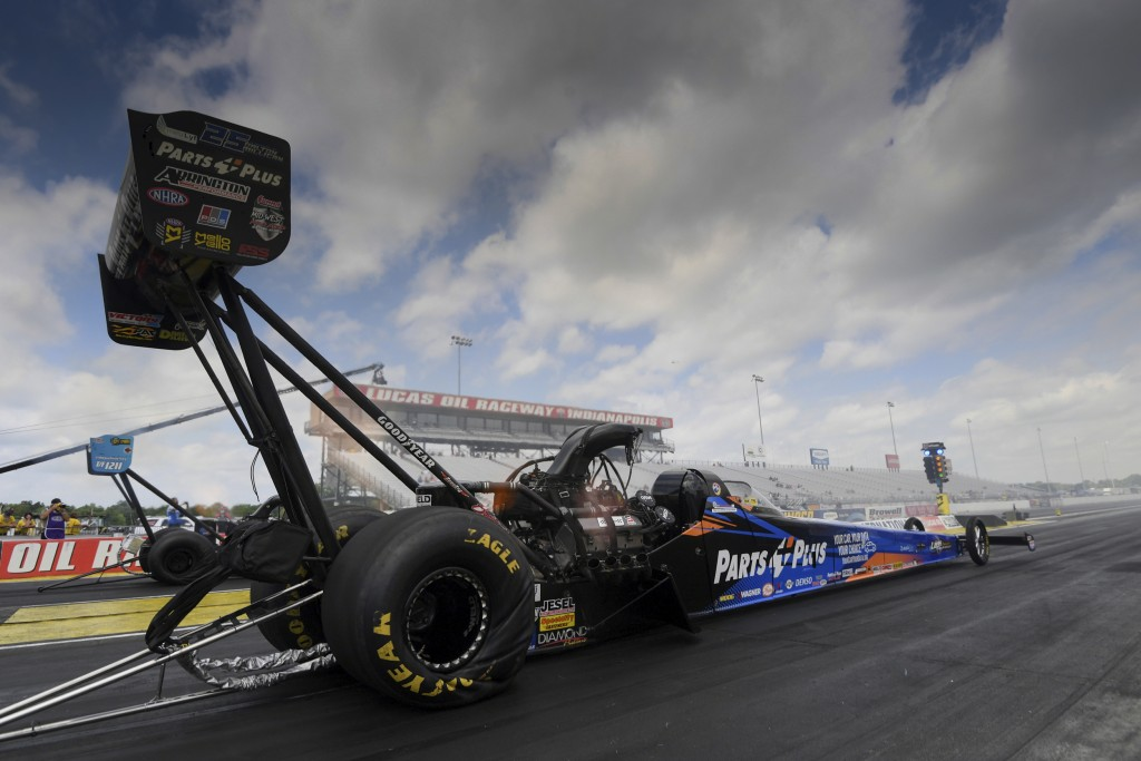 In this photo provided by the NHRA, Top Fuel's Clay Millican powers his way to the top spot to wrap up qualifying at the Lucas Oil NHRA Summernational...