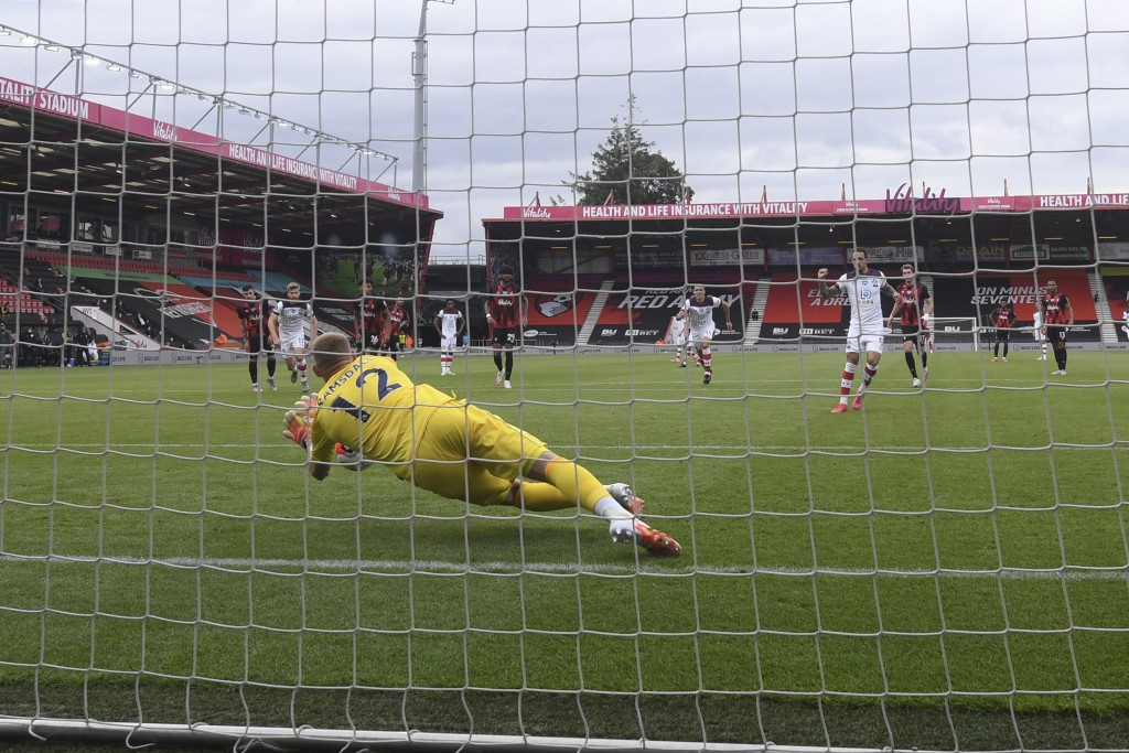 Bournemouth's goalkeeper Aaron Ramsdale saves a penalty during the English Premier League soccer match between Bournemouth and Southampton, at the Vit...