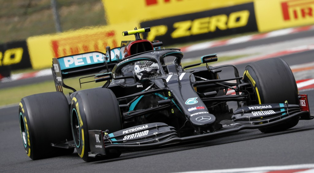 Mercedes driver Valtteri Bottas of Finland steers his car during the Hungarian Formula One Grand Prix race at the Hungaroring racetrack in Mogyorod, H...