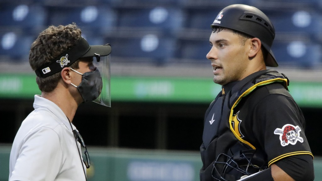FILE - In this July 15, 2020, file photo, Pittsburgh Pirates catcher Luke Maile, right, talks with a trainer during an intrasquad baseball game at PNC...