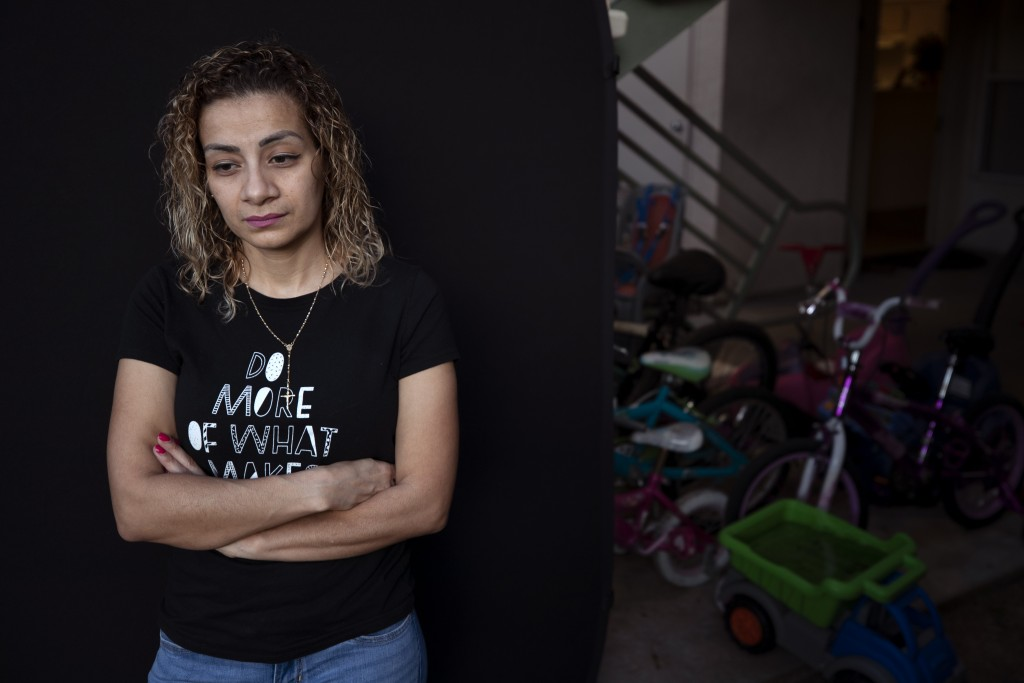 Issis Zavala, of Honduras, poses for a picture Thursday, May 7, 2020, in Carlsbad, Calif. Zavala was detained at the Otay Mesa Detention Center before...