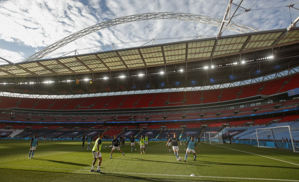 Manchester City players warm up ahead of the FA Cup semifinal soccer match between Arsenal and Manchester City at Wembley in London, England, Saturday...