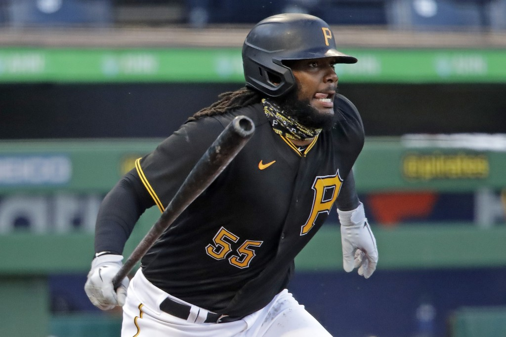 Pittsburgh Pirates' Josh Bell grounds out to Cleveland Indians first baseman Carlos Santana on a pitch from Indians starting pitcher Zach Plesac durin...