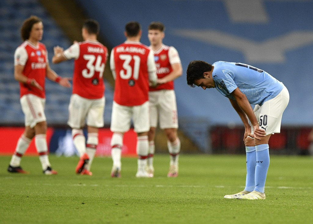 Manchester City's Eric Garcia reacts after the FA Cup semifinal soccer match between Arsenal and Manchester City at Wembley in London, England, Saturd...