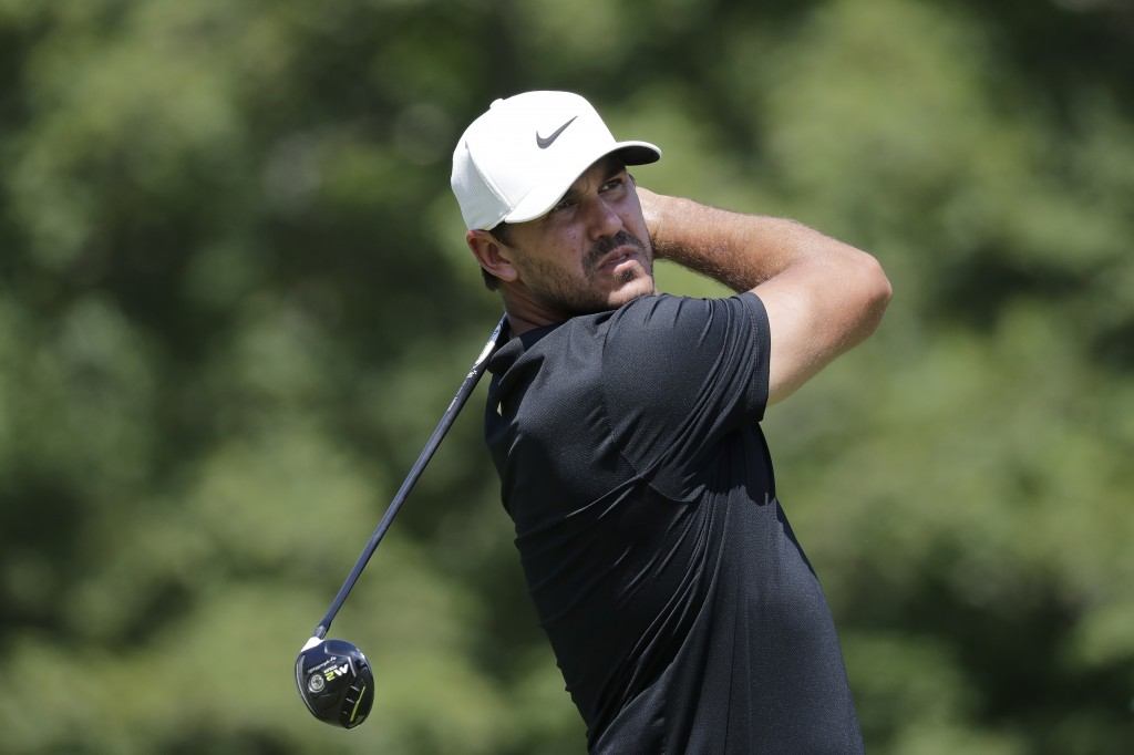 Brooks Koepka hits from the 18th tee during the third round of the Memorial golf tournament, Saturday, July 18, 2020, in Dublin, Ohio. (AP Photo/Darro...