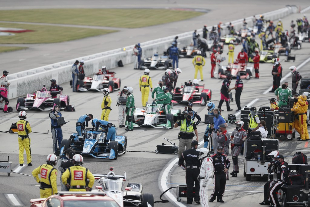 Drivers get set on pit road before an IndyCar Series auto race Saturday, July 18, 2020, at Iowa Speedway in Newton, Iowa. (AP Photo/Charlie Neibergall...