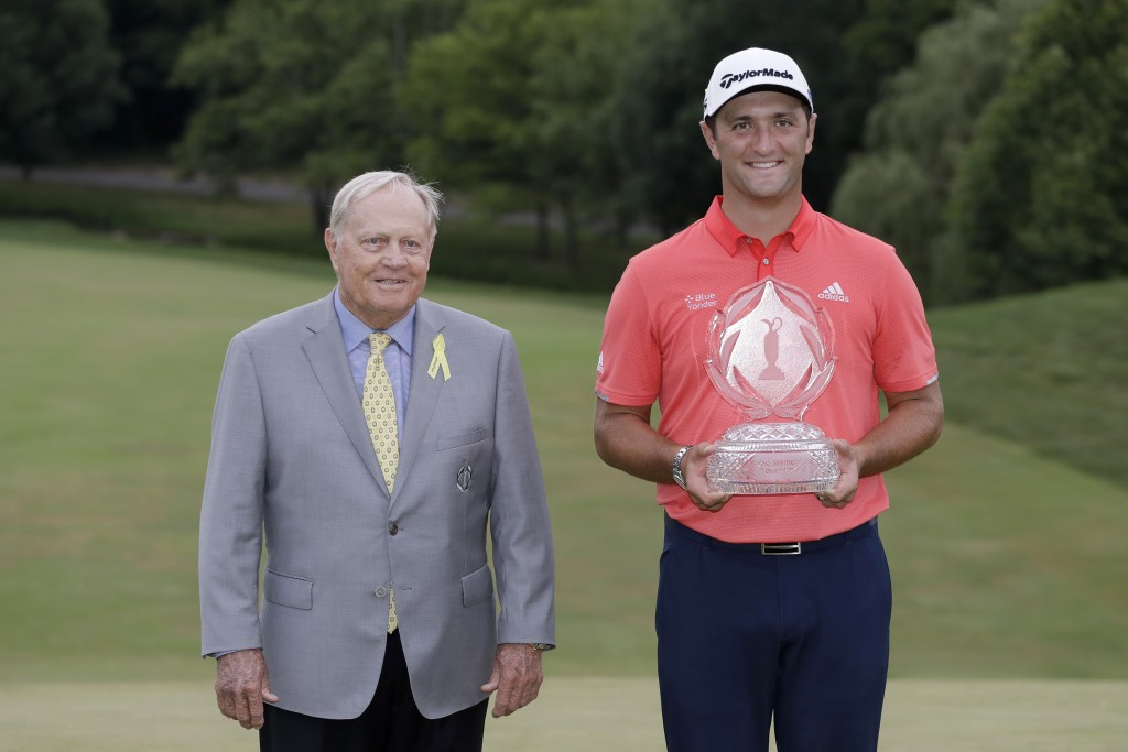 Jon Rahm, of Spain, right, poses with Jack Nicklaus and the trophy after winning the Memorial golf tournament, Sunday, July 19, 2020, in Dublin, Ohio....