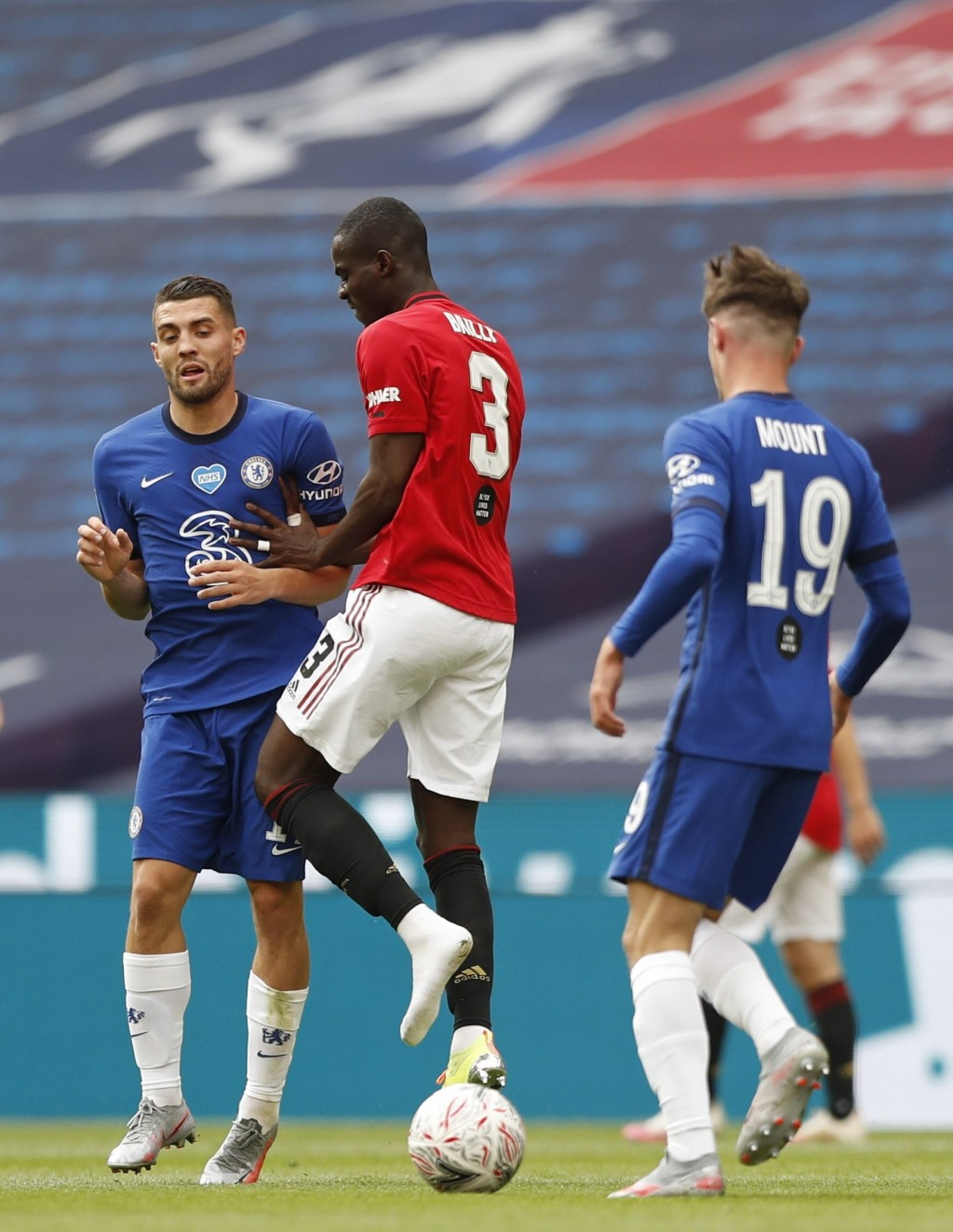 Manchester United's Eric Bailly loses his boot during the English FA Cup semifinal soccer match between Chelsea and Manchester United at Wembley Stadi...