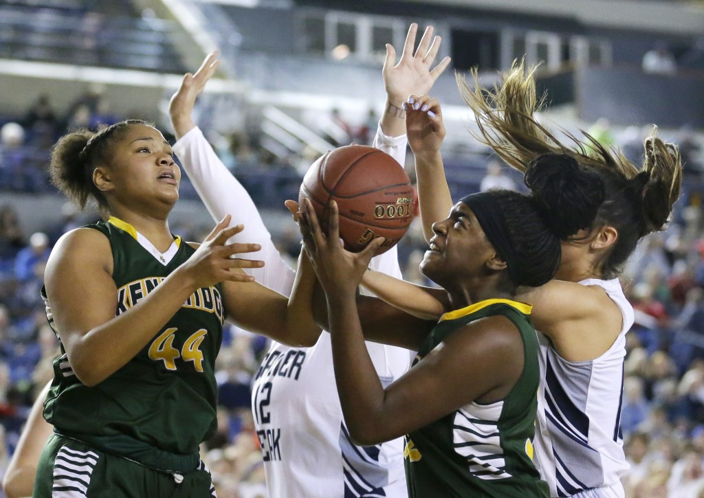 FILE - In this March 5, 2016 file photo, Kentridge's JaQuaya Miller (44) and Jordyn Jenkins, second from right, battle for a rebound against Glacier P...
