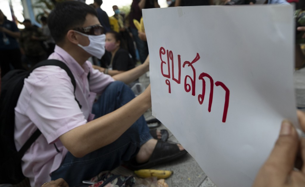 """Anti-government protesters hold signs reading """"dissolve parliament"""" as they gather in front of the Royal Thai ArmyHeadquarters in Bangkok, Thailand, ..."""