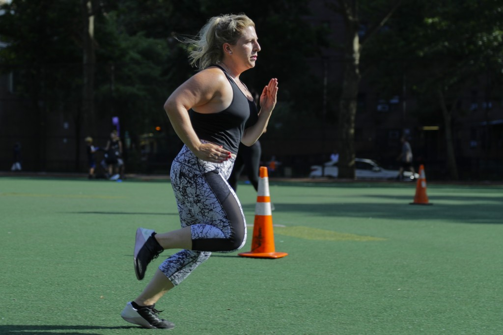 Lauren Wire works out during a fitness class Wednesday, July 15, 2020, in New York. Many Americans are changing clothing sizes depending on how they s...