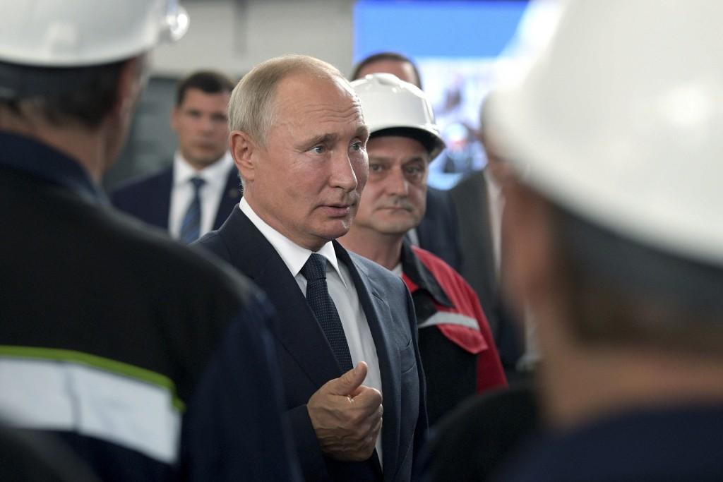 Russian President Vladimir Putin speaks to workers at the Zaliv shipyard in Kerch, Crimea, Monday, July 20, 2020. Russian President Vladimir Putin on ...
