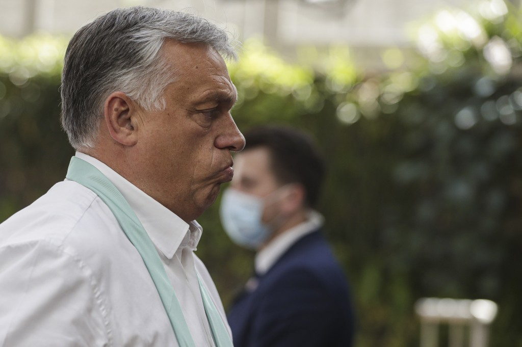 Hungary's Prime Minister Viktor Orban arrives for an EU summit in Brussels, Monday, July 20, 2020. Leaders from 27 European Union nations stretch thei...