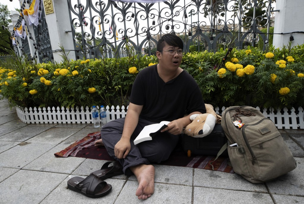 Activist Pumiwat Rangkasiwit begins a hunger strike outside Government House in Bangkok, Thailand, Monday, July 20, 2020. Pumiwat is part of a group o...