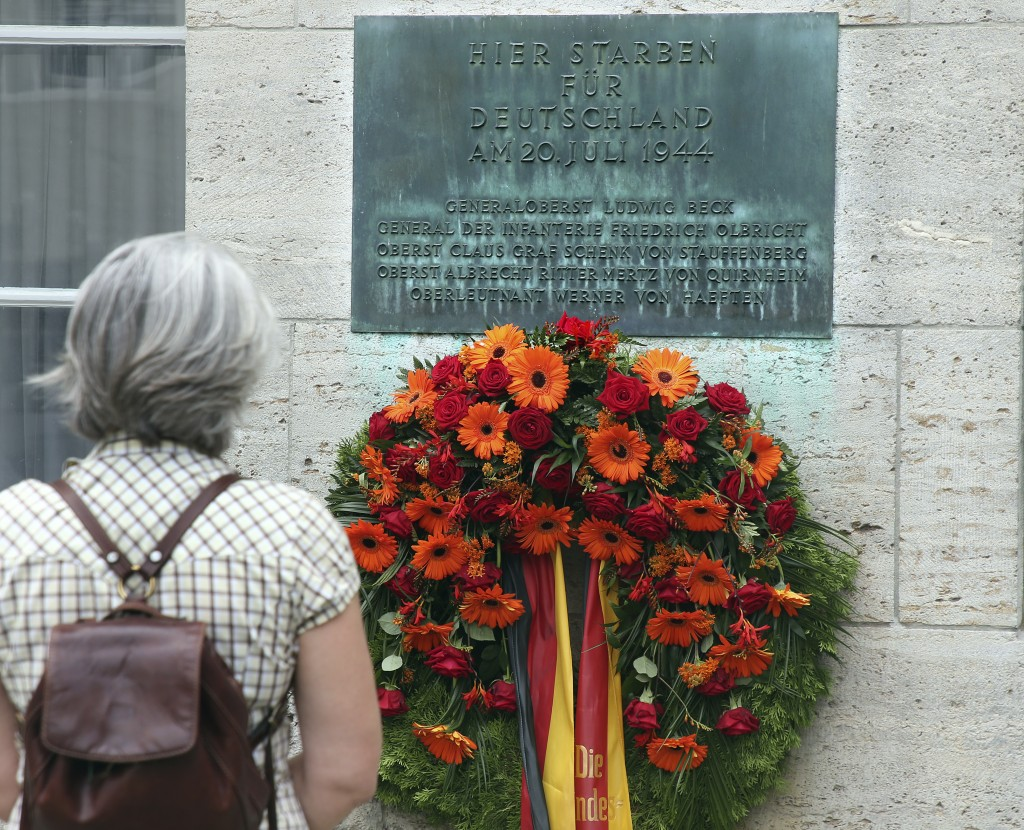 A woman stands in the Bendler Block at the German Resistance Memorial Center on the spot where Claus Graf Schenk von Stauffenberg and other officers w...