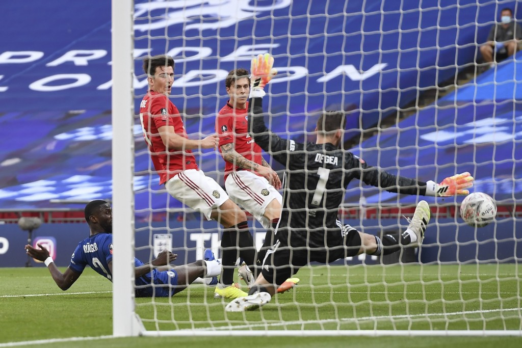 Manchester United's goalkeeper David de Gea fails to stop the third goal during the English FA Cup semifinal soccer match between Chelsea and Manchest...