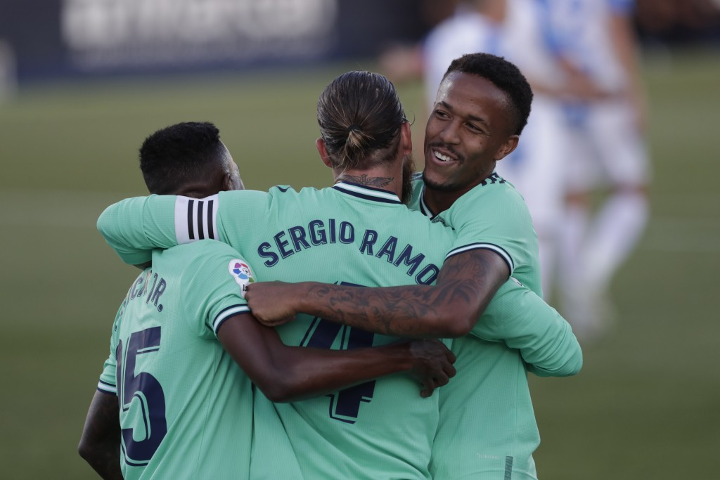 Real Madrid's captain Sergio Ramos, centre, celebrates with teammates after scoring during the Spanish La Liga soccer match between Leganes and Real M...