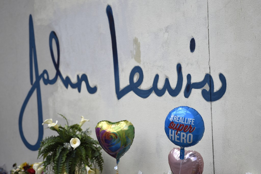 Balloons and other mementos are seen at a make-shift memorial near the home of Rep. John Lewis, D-Ga., Sunday, July 19, 2020, in Atlanta. Lewis, who d...