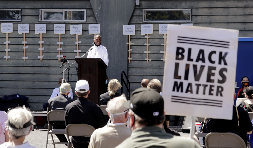 Deacon Joseph Conner speaks at an outdoor prayer vigil for racial justice at Immaculate Conception Catholic Church Sunday, July 19, 2020, in Seattle. ...