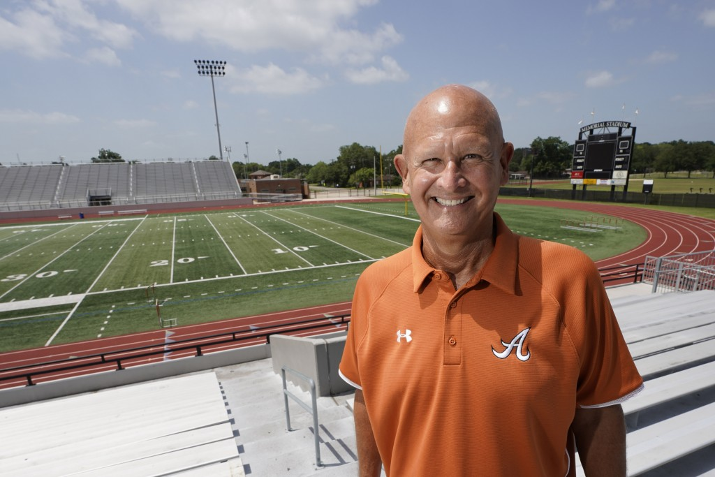 Alvin High School football coach Tim Teykl poses inside Alvin Memorial Stadium Tuesday, July 14, 2020, in Alvin, Texas.  The overwhelming uncertainty ...