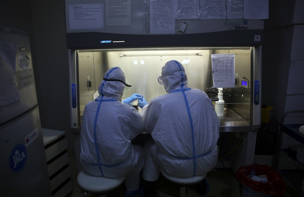 Afghan lab technicians test samples at the Afghan-Japan Communicable Disease Hospital, treating COVID-19 patients in Kabul, Afghanistan, Tuesday June ...