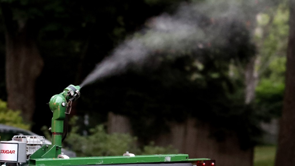 A vapor, sprayed to control mosquitos, hangs airborne as it leaves the nozzle of a East Middlesex Mosquito Control Project pick-up truck on Wednesday,...