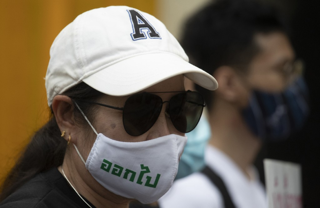 """Anti-government protesters wear face masks that read """"Get Out"""" as they gather in front of the Royal Thai ArmyHeadquarters in Bangkok, Thailand, Monda..."""
