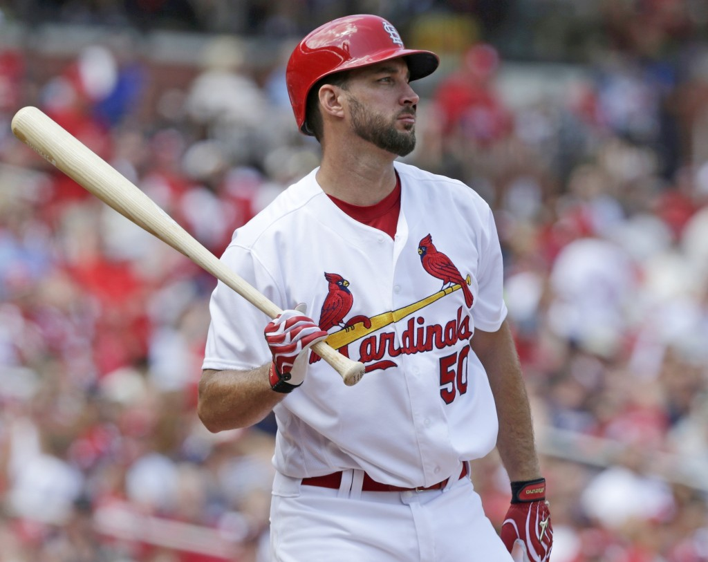 FILE - In this Sunday Aug. 7, 2016 file photo, St. Louis Cardinals' Adam Wainwright (50) bats in a baseball game against the Atlanta Braves in St. Lou...