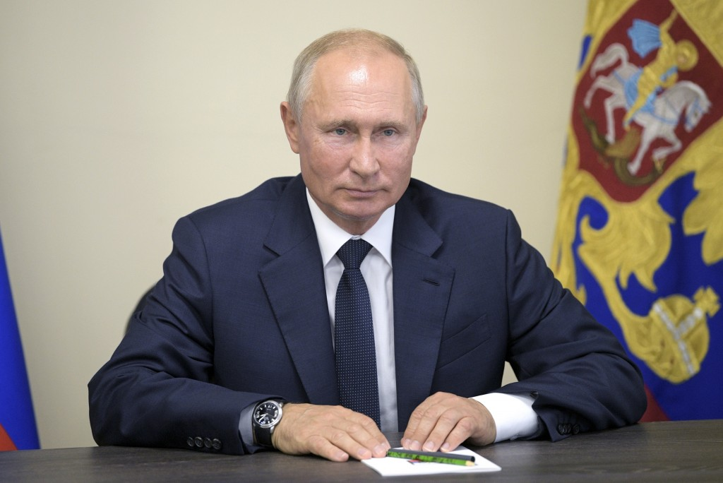 Russian President Vladimir Putin speaks during a video conference with Liberal Democratic Party members after visiting the Zaliv shipyard in Kerch, Cr...