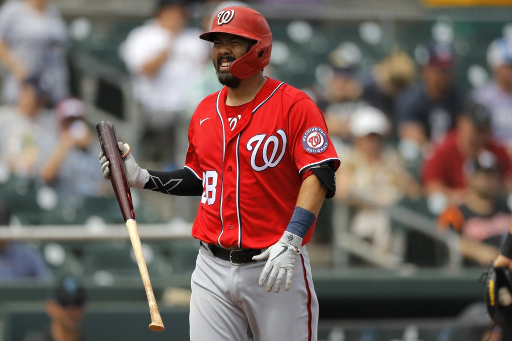 FILE - In this March 10, 2020, file photo Washington Nationals' Kurt Suzuki reacts after striking out to Miami Marlins pitcher Caleb Smith during the ...