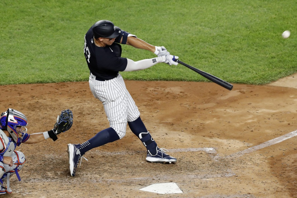 New York Yankees Aaron Judge hits a two-run, home run during the sixth inning of an exhibition baseball game against the New York Mets, Sunday, July 1...