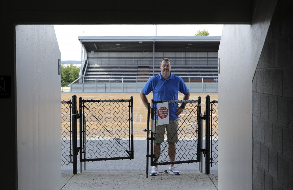 Mick Hoffman, executive director of the Washington Interscholastic Activities Association, poses for a photo, Thursday, July 16, 2020, near empty stan...