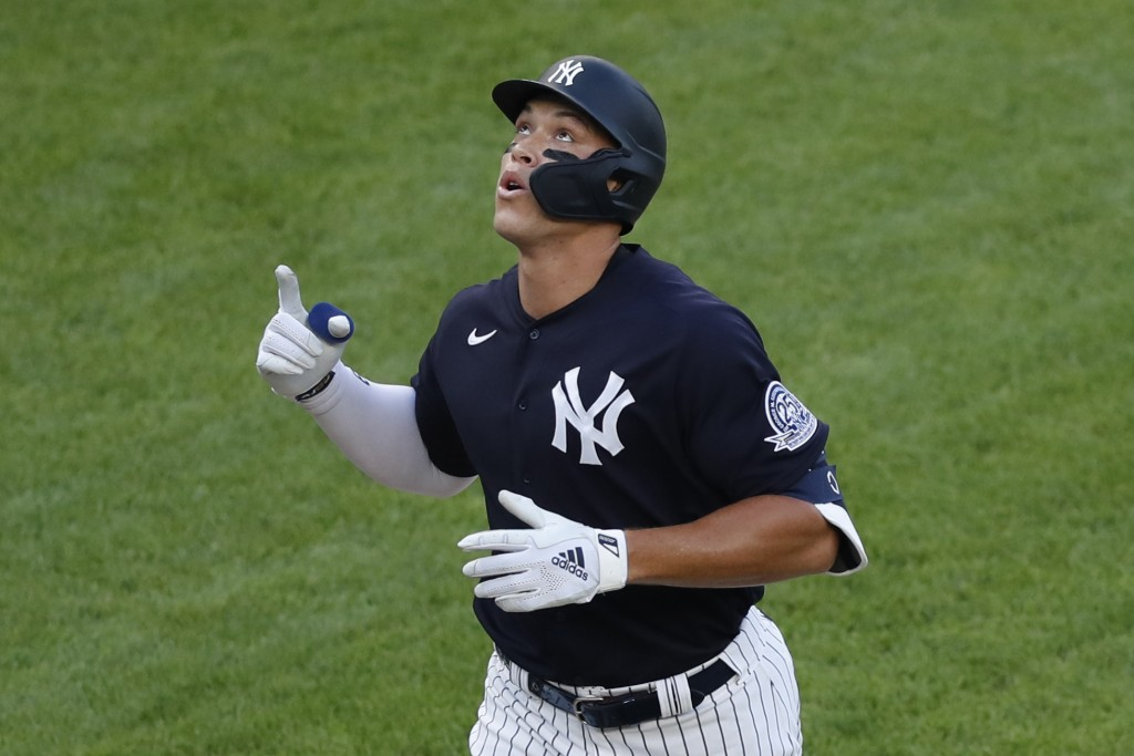 New York Yankees' Aaron Judge points skyward after hitting a solo home run during the first inning of an exhibition baseball game against the New York...