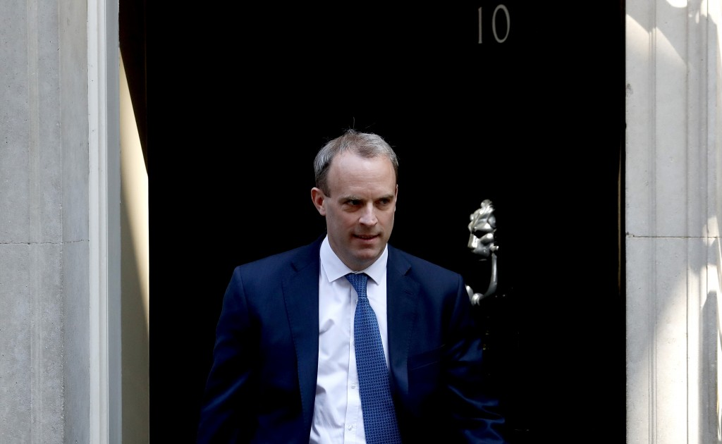 FILE - In this Wednesday April 22, 2020 file photo, Britain's Foreign Secretary Dominic Raab leaves 10 Downing Street, London. Britain's foreign secre...