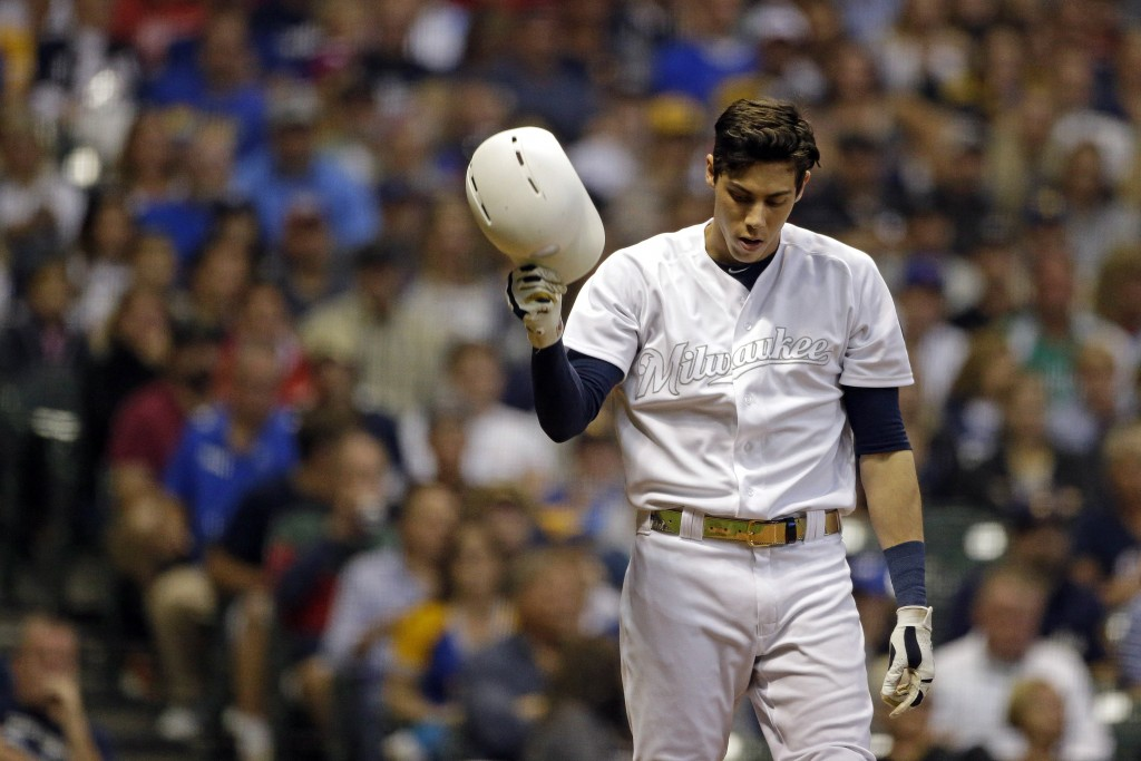 FILE - In this Aug. 24, 2019, file photo, Milwaukee Brewers' Christian Yelich reacts after striking out during the fourth inning of a baseball game ag...