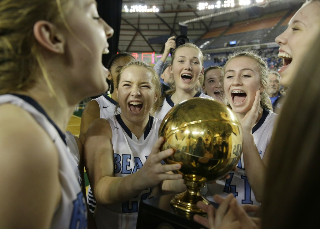FILE - In this March 5, 2016 file photo, Central Valley players celebrate with the trophy after they beat Snohomish to win the Washington state girls ...