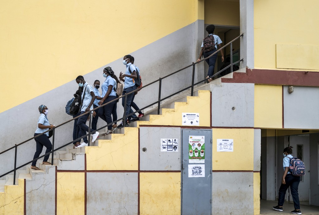 FILE - In this June 25, 2020, file photo, Senegalese students wear masks to curb the spread of the coronavirus as they return to classes on the first ...