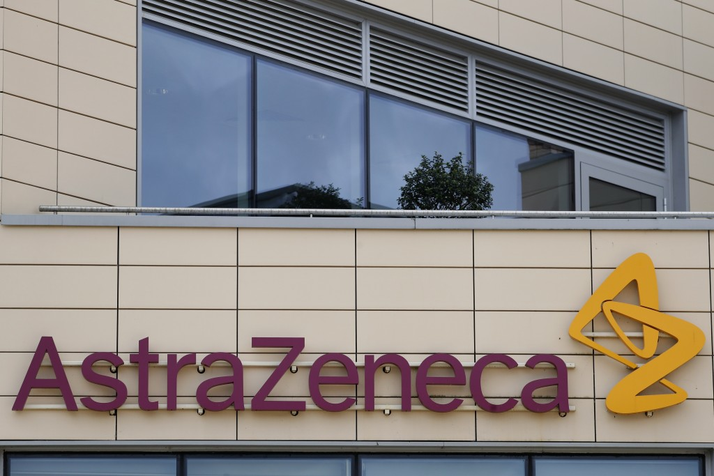 FILE - In this Saturday, July 18, 2020 file photo a general view of AstraZeneca offices and the corporate logo in Cambridge, England. Scientists at Ox...