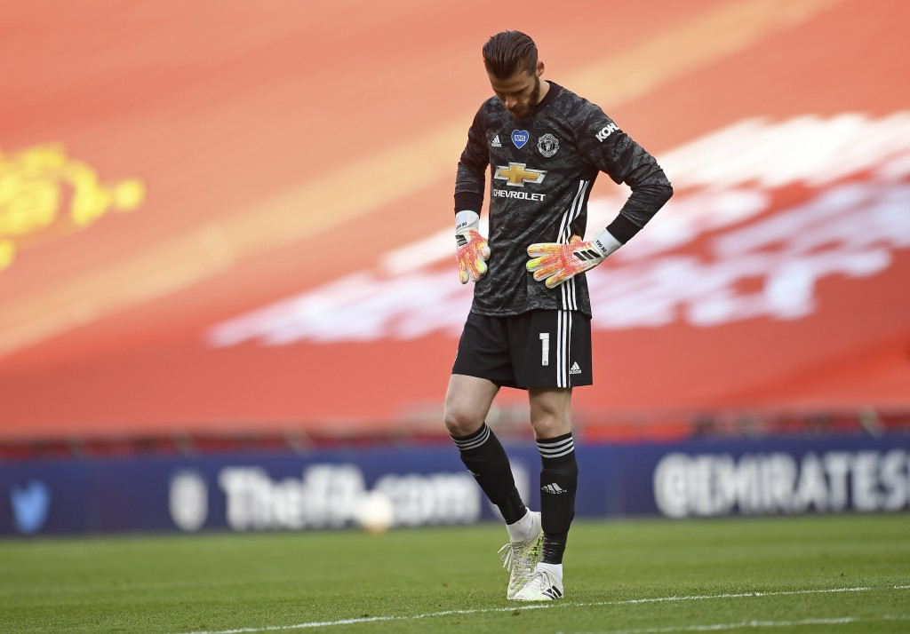 Manchester United's goalkeeper David de Gea looks down after conceding the second goal during the English FA Cup semifinal soccer match between Chelse...