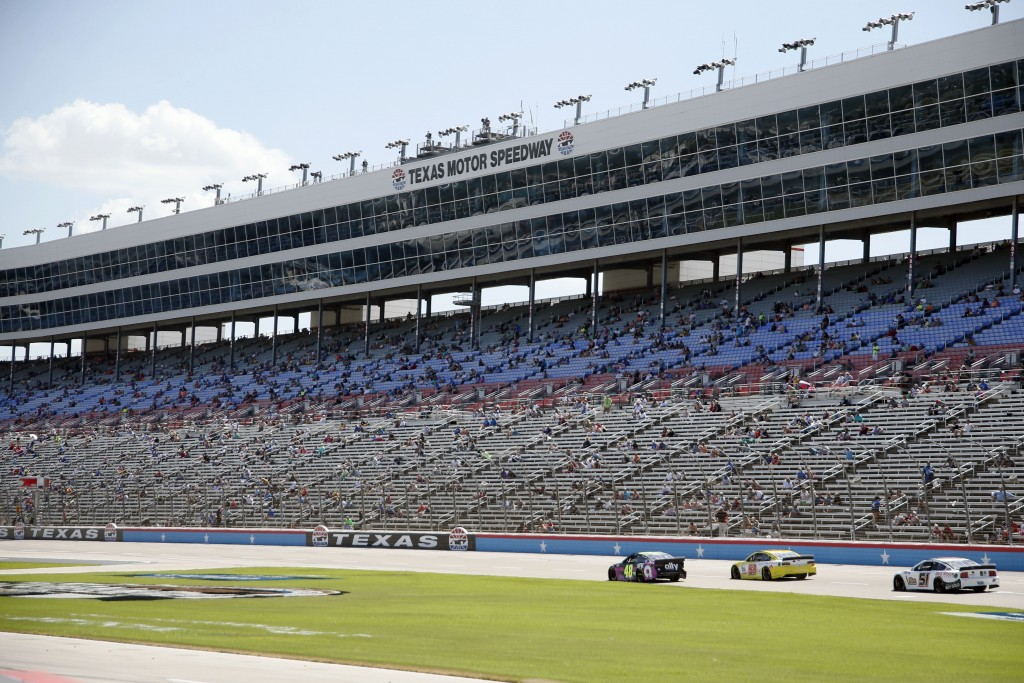 The grandstand is viewed at Texas Motor Speedway during a NASCAR Cup Series auto race in Fort Worth, Texas, Sunday, July 19, 2020. (AP Photo/Ray Carli...