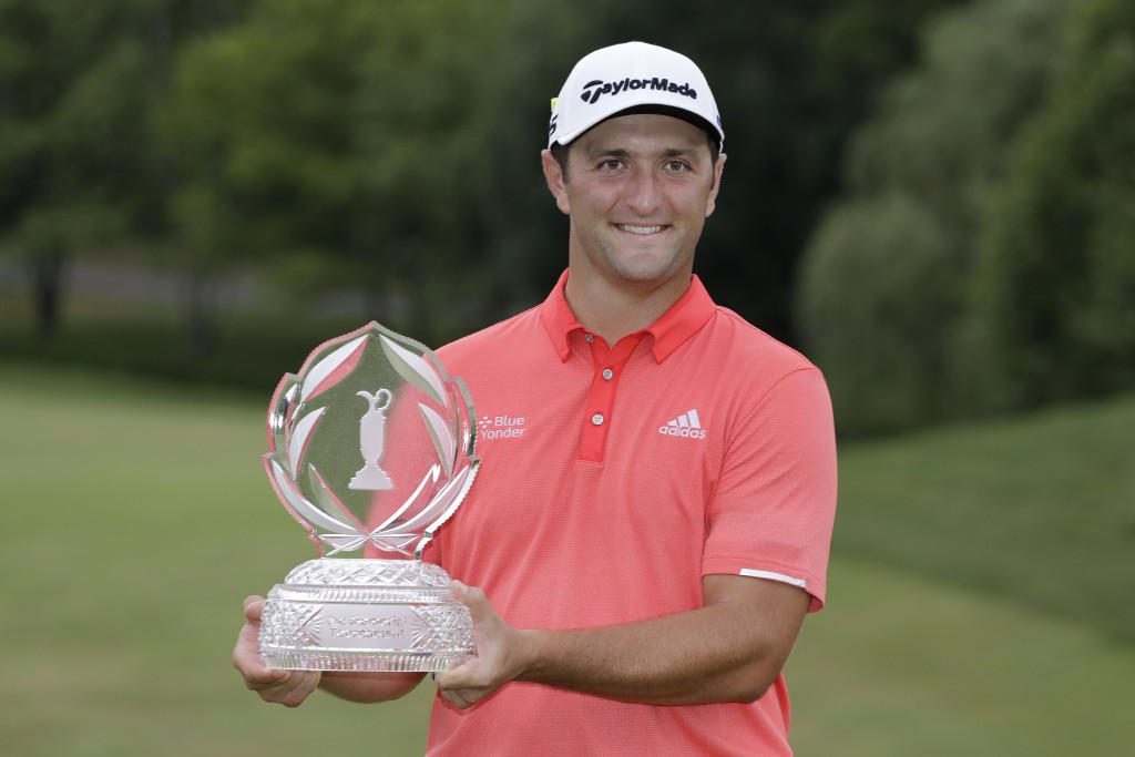Jon Rahm, of Spain, poses with the trophy after winning the Memorial golf tournament, Sunday, July 19, 2020, in Dublin, Ohio. (AP Photo/Darron Cumming...