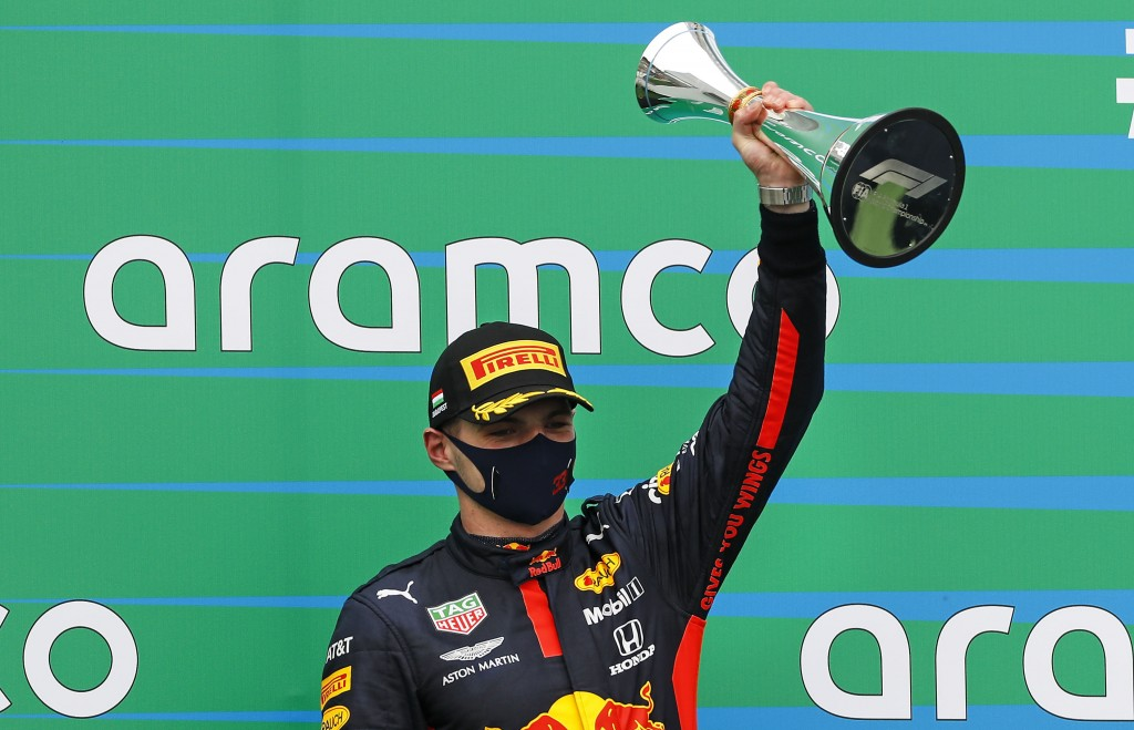 Red Bull driver Max Verstappen of the Netherlands celebrates with a trophy his second place after the Hungarian Formula One Grand Prix race at the Hun...