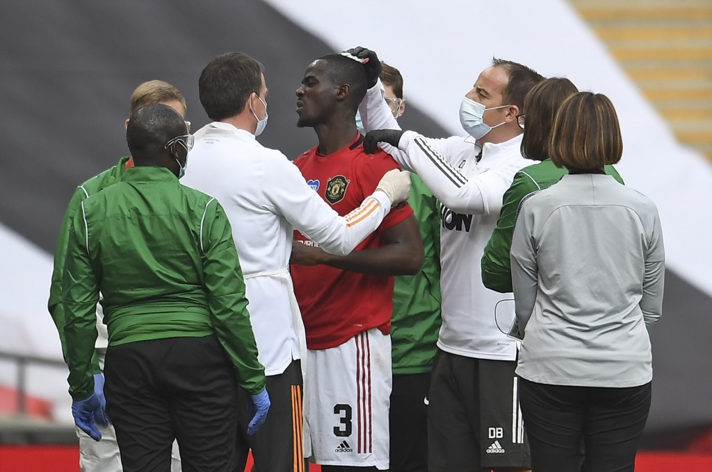 Manchester United's Eric Bailly receives treatment after a clash of heads during the English FA Cup semifinal soccer match between Chelsea and Manches...
